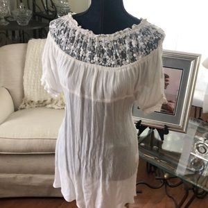 This is a super cute gauze and lace expensive top!